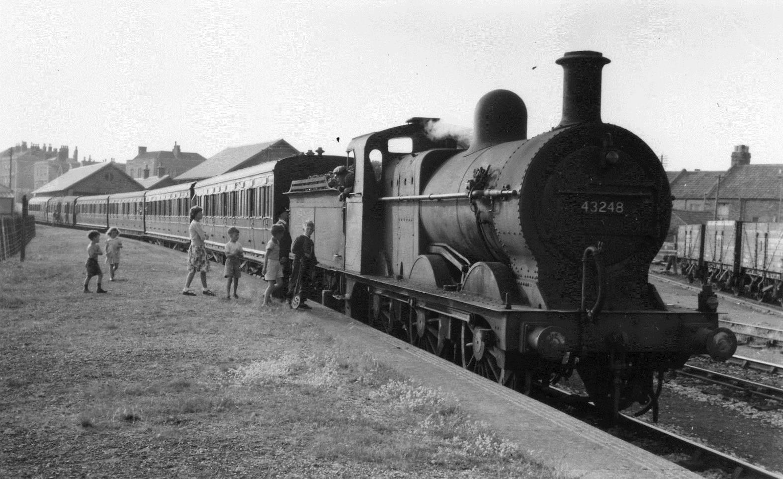 Train about the leave the Excursion Platform on 30th July 1955.Of interest The children are - from left to right - David Strickland, Sara Trotman, Christine Calvary, John Strickland, Judith Stevenson and Lenard Thompson.